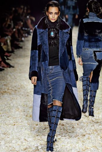 Look 11 from the TOM FORD AW15 Womenswear Collection #TOMFORD | Indigo mink patchwork coat, fine rib turtle neck, denim trouser skirt, patchwork knee high boot, turquoise egg in black feather nest necklace.