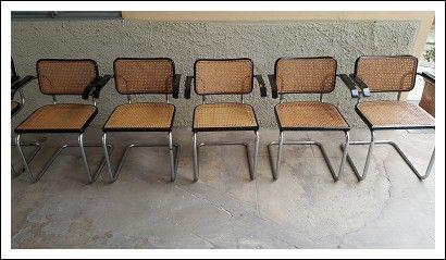 Sedie in metallo curvato con braccili in legno ebanizato con seduta e schienale in paglia di vienna anni 70 mis 55x55 h 90