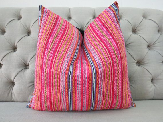 A unique cushion cover created by Vintage Hmong-textile. The front is A Vintage Handwoven Hmong Cotton with a pattern which has been naturally Handwoven and dyed, All of the dyes are made from plants and resins. The back is plain 100% Chiangmai cotton and it closes with a zip at the bottom.  PLEASE NOTE: Each piece will contain subtle marks, miss aligned prints and slight wear from its past life which is only natural due to the nature of vintage and hand printed textiles. I consider these…