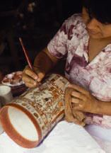 Mayan Fine Artist Patricia painting one of her creations displayed in our Toh Boutique at Chichen Itza, Yucatan, Mexico