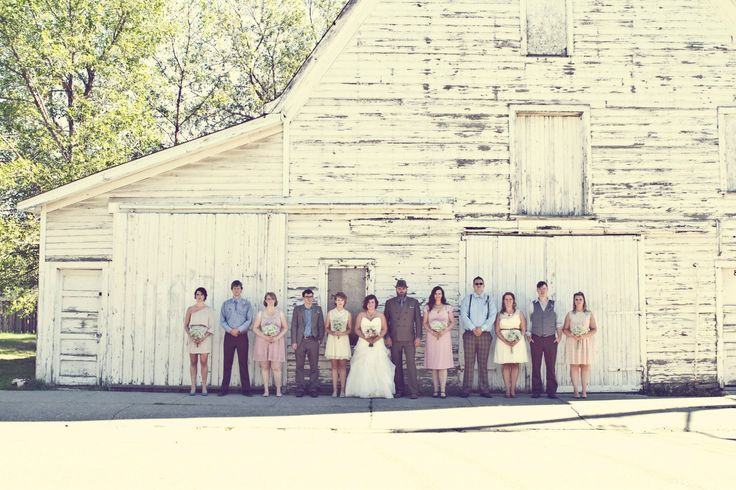 Rustic white barn photo with wedding party. Jessica + Cameron's Country Vintage Wedding | Design + Styling by Kismet & Clover