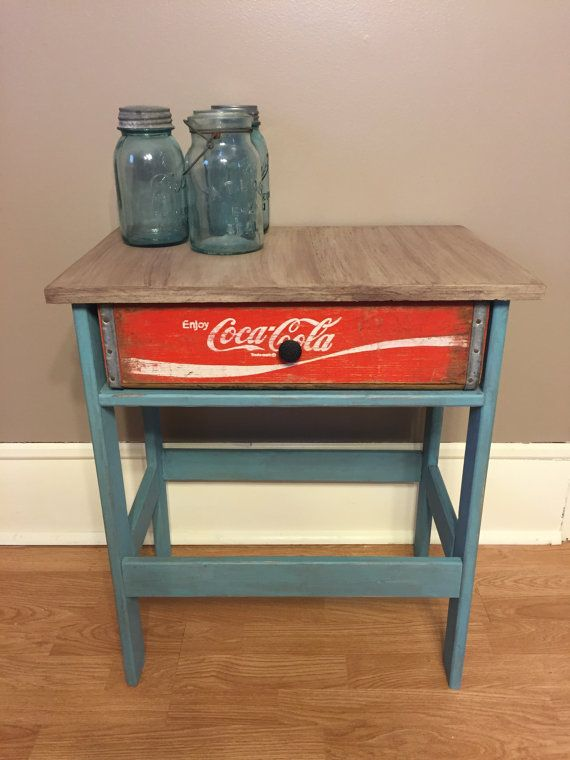 This table has been handcrafted from wood salvaged from other projects with a Coca Cola soda crate upcycled into a working drawer. The table