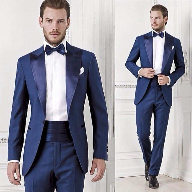 Putting together a blue tuxedo design for a client's wedding and just came across this from #SartoriaRossi. From the length & width of the satin peak lapels down to the overall cut, what you see here is perfection (aside from his left sleeve not revealing any shirt cuff). As for the finishing touch: a satin cummerbund matching the lapels and bow tie.