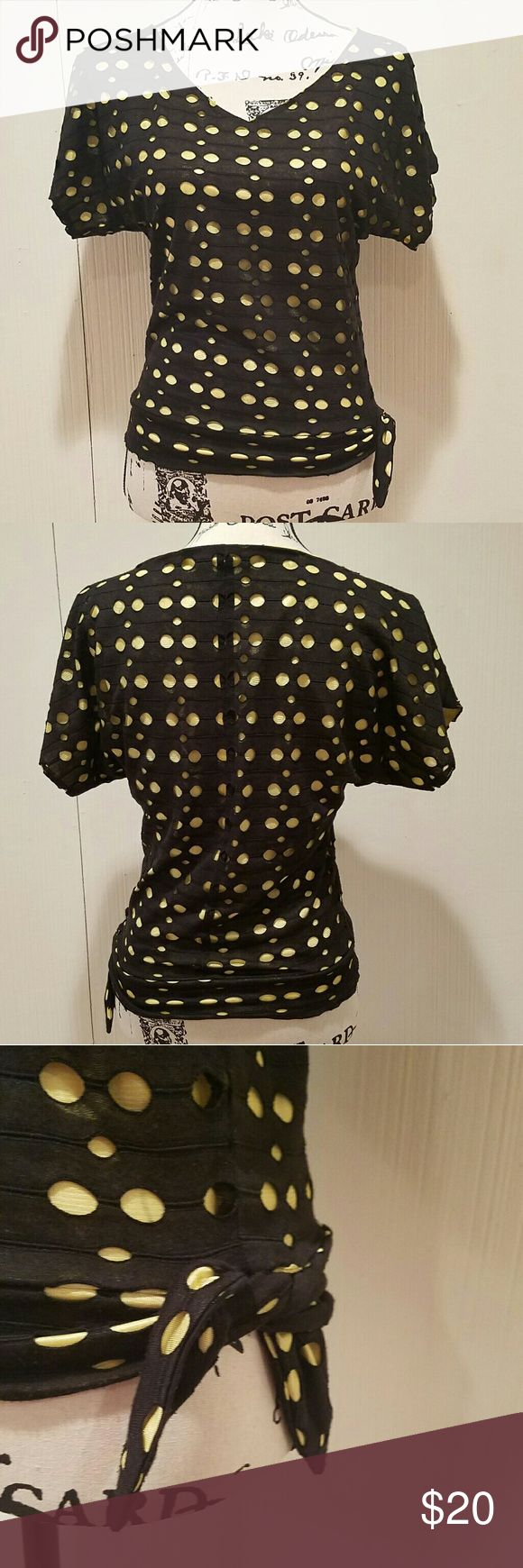 Black and yellow polka dot short sleeve top Adorable polka dot short sleeve top. Yellow lining and black over layer with holes. Side tie. Some slight pulls on lining (as shown in picture) but barely noticeable. Very small damage on front of shirt as shown in picture, not even noticeable. Top in very good condition. No tag so unsure of brand and size, but fits like a small. Tops Blouses
