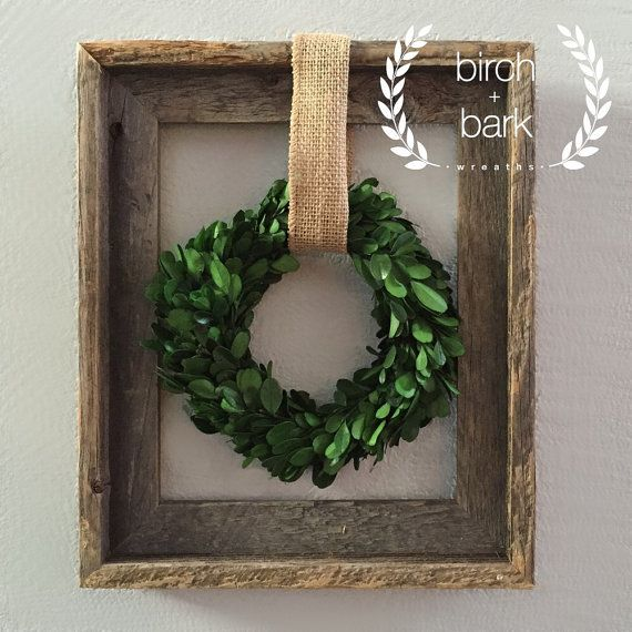 Preserved boxwood wreath (dimensions 7 in diameter) with wood frame (dimensions 13 in x 11 in) wall decor. Can be used year round for indoor