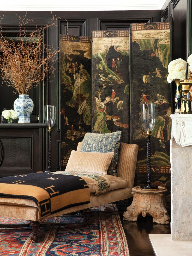 Custom chaise and an 18th-century Coromandel screen from Bonhams, L.A. in the media room.