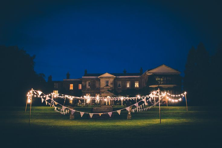 Festoon Lights & Bunting - Image by Blondie Photography - Image By Blondie Photography - Bespoke Lace Wedding Dress, Mis-match Pastel Bridesmaids & Navy Groomsmen for a school themed reception & rustic festival after party wedding in Devon.