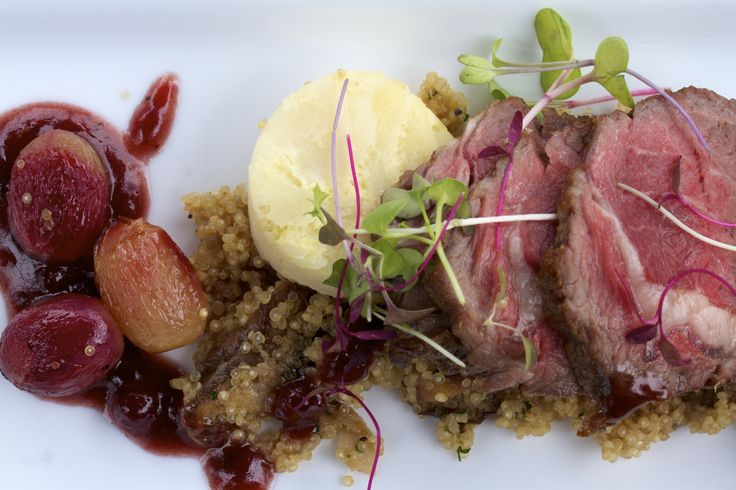 Smoked lamb loin over a quinoa, roasted grape, and mushroom salad with ...