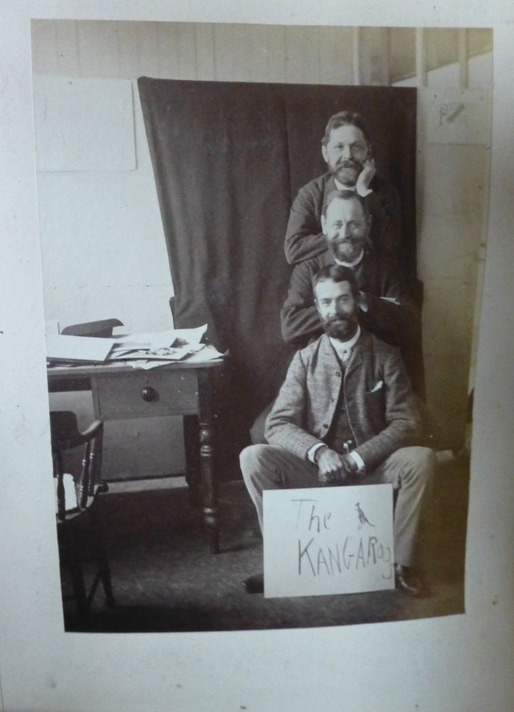 One of several joking photos made in the offices of the Picturesque Atlas of Australasia. In the middle is Schell, and below is probably William Fitler.  The shot may have been made by A.K. Syer, the Sydney photographer