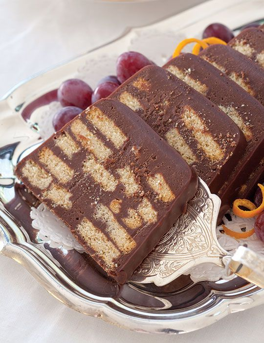 Chocolate Biscuit Cake, made with tea biscuits and chocolate ganache, is a modern-day favorite of both Queen Elizabeth II and her grandson, Prince William.