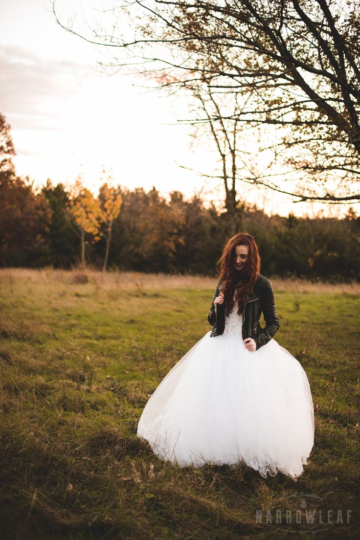 Moody bride in a white tutu wedding dress wearing a leather jacket.