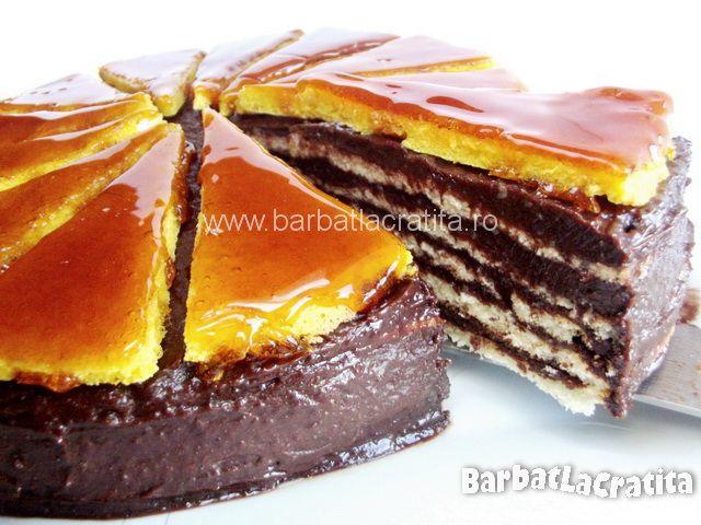 "Tort Dobos cu glazura de zahar ars, crema de ciocolata si foi gen ""clatita""."