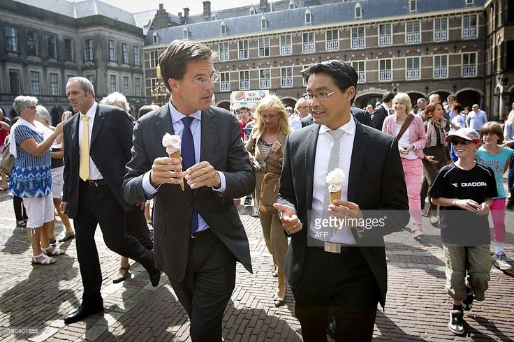 Dutch prime minsiter Mark Rutte (L) and Germany's economy minister Philipp Rosler (R) eat ice cream on the Binnenhof in The Hague, on August 16, 2012. Rosler pays a visit to The Netherlands to talk about the Eurozone crisis.AFP PHOTO/ ANP EVERT-JAN DANIELS netherlands out