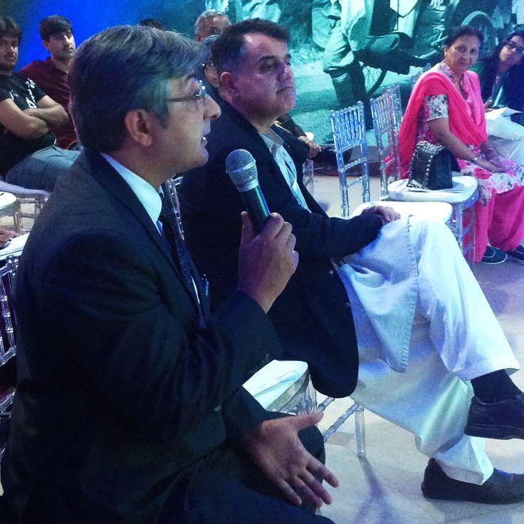 TV anchor Farrukh K Pitafi speaking to the panelists.