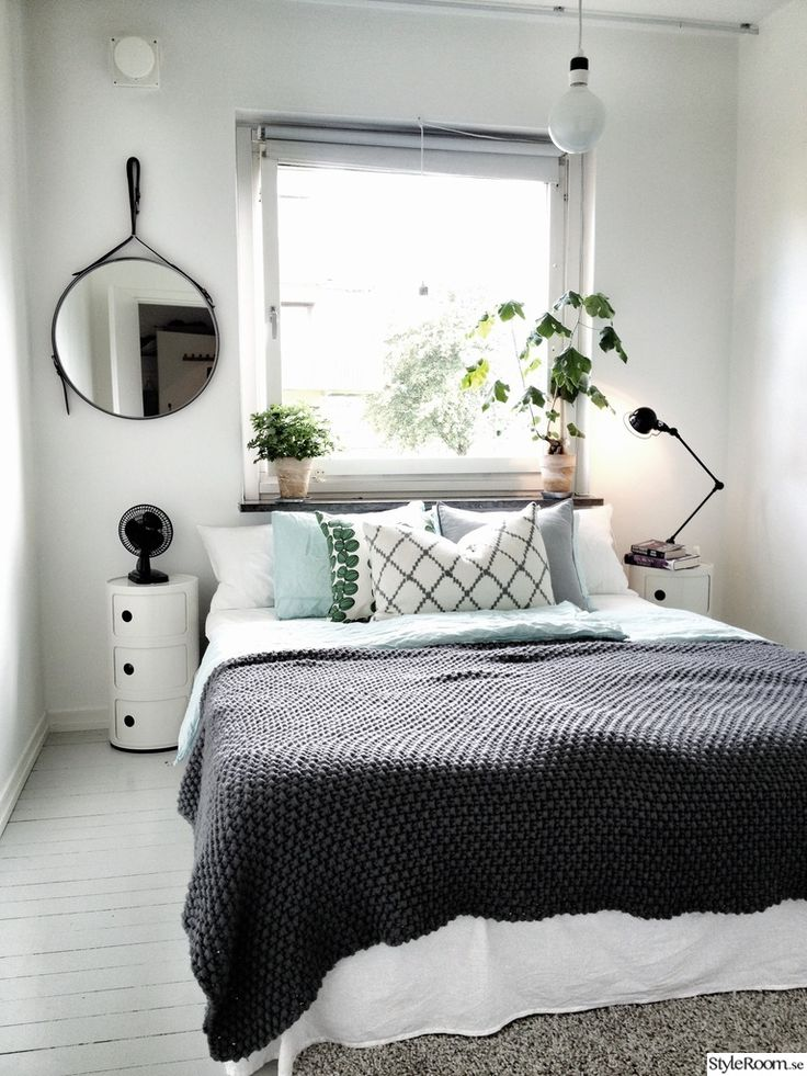 Compact living bedroom, LOVE the plants in the window!!