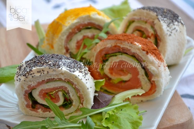 Girelle salmone e rucola, un antipasto sfizioso ideale per il veglione di Capodanno, si prepara facilmente anche in anticipo e si serve a girella.
