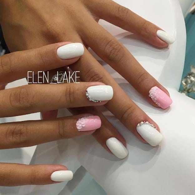Wedding Nail Art Designs - Floral Pink and White Bling - Beautiful And Classy Nailart and Nail Ideas for The Bride and The Bridesmaid that you will Love. These posts contain Ideas For French Manicures, Silver, Blue, Red, Pale Pink, Simple, And Sparkle Nail Ideas. There Are Step By Step Tutorials And Make For Awesome Bling For Weddings, Prom, Graduation, or any Event On The Town - https://thegoddess.com/wedding-nail-art-design