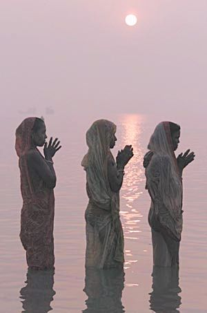 Pink and Grey ~ Hindu women praying in the Ganges River