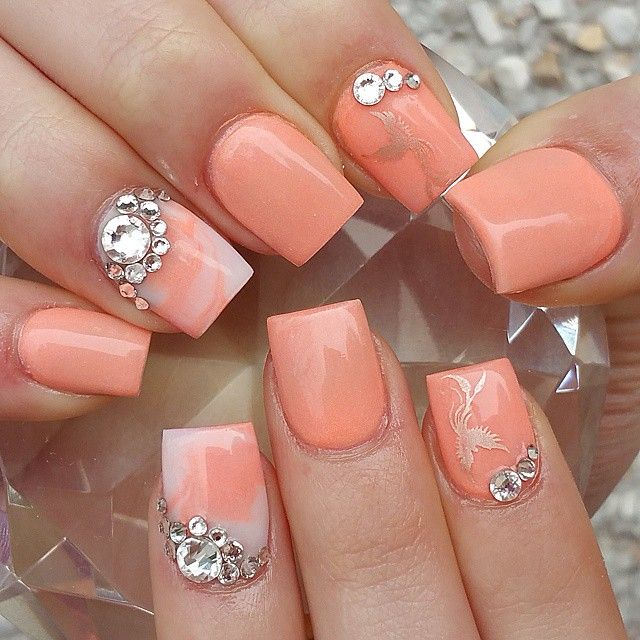 Short peach nails with bling