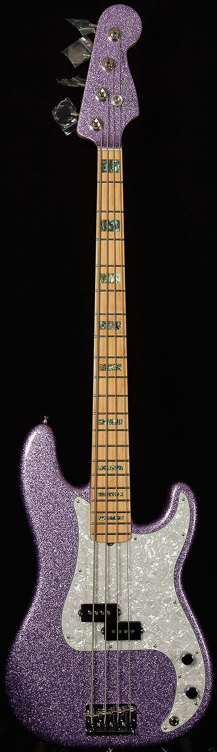 Fender Precision in purple sparkle. This is the Adam Clayton sig model, I think. Still, purple!