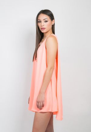 NEON CORAL TROPICS DRESS      No need to worry about anything showing in this dress. Its elongated slip has you covered and gives the illusion of two layered dresses. Yep, this piece will instantly become a classic go-to in your wardrobe.