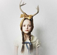 the headband is cute There seems to be a tension between the antlers and the girls head, like the ribbon is struggling to keep it on.