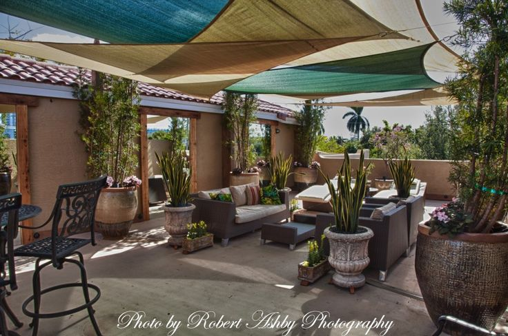 Shade sails rooftop patio outdoor living spaces for Rooftop patio garden ideas