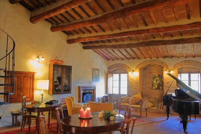 In our living room you could read a book, play the piano, drink some excellent wine or sip a cup of tea in front of the hearth...