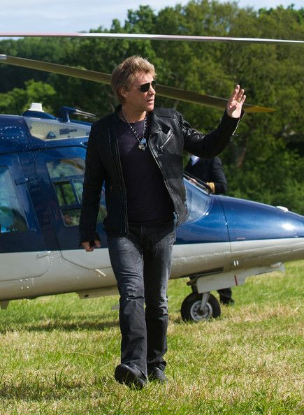 Jon Bon Jovi Photos Photos -   Tico Torres, Jon Bon Jovi and David Bryan arrive by helicopter ahead of their performance on day 4 of the Isle of Wight Festival at Seaclose Park on June 16, 2013 in Newport, Isle of Wight. (Photo by Rob Harrison/Getty Images). - Bon Jovi Arrive By Helicopter at the Isle of Weight