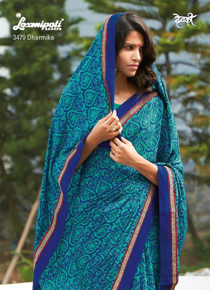 The crape sky blue - blue saree possess a gorgeous stencil print, fancy lace and crape blouse.