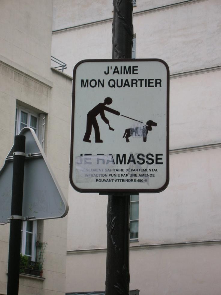 Poop scooper in Le Marais, Paris