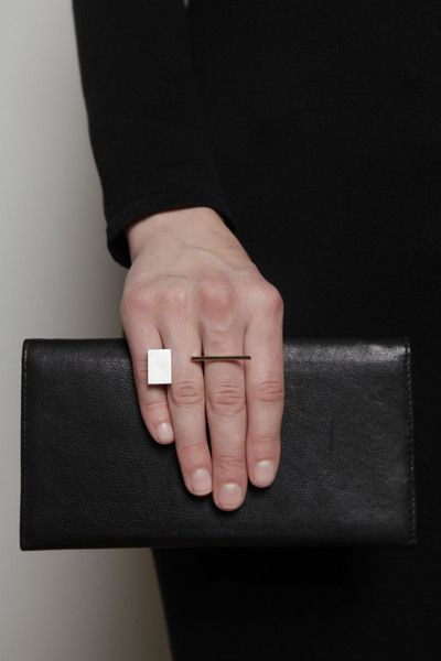 """Geometric ring with open front, inspired by the work of Bauhaus master weaver, Gunta Stölzl. Handcrafted of sterling silver and 18k yellow gold.  MEASURE Face, 2"""" length; height, 11/16"""" at tallest point"""