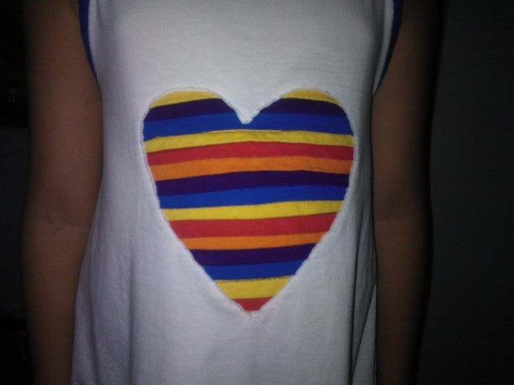 Girl's dress made of second hand T-shirts. Heart made of sleeves' trimmings.