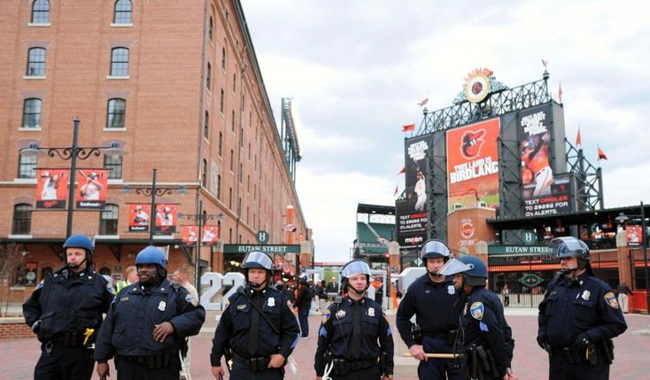 Baltimore police officers stand outside the stadium prior to the cancellation of the game between the Chicago White Sox and Baltimore Orioles at Oriole Park at Camden Yards. Photo: Evan Habeeb-USA Today Sports Newsweek | As Riots Consume Baltimore, Orioles Postpone Baseball Game