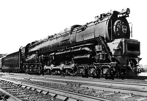 Pennsylvania Railroad Baldwin S-2 class 6-8-6 Steam Turbine Locomotive # 6200, seen at an unknown location with a passenger train, unknown Photographer, mid 1940's, courtesy Charles Snyder Collection