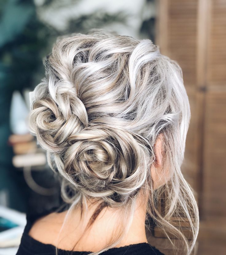 This casual, messy updo was done for a holiday event I hosted. I love this floral updo, fun hairstyle for medium length hair. | Updo ideas, white blonde hair, blonde hair color, taupe hair color, silver hair color, casual updo, wedding updo, wedding hairstyle for medium hair, wedding hair ideas