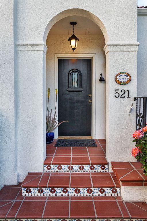 Mediterranean Front Door with exterior terracotta tile floors, Glass panel door