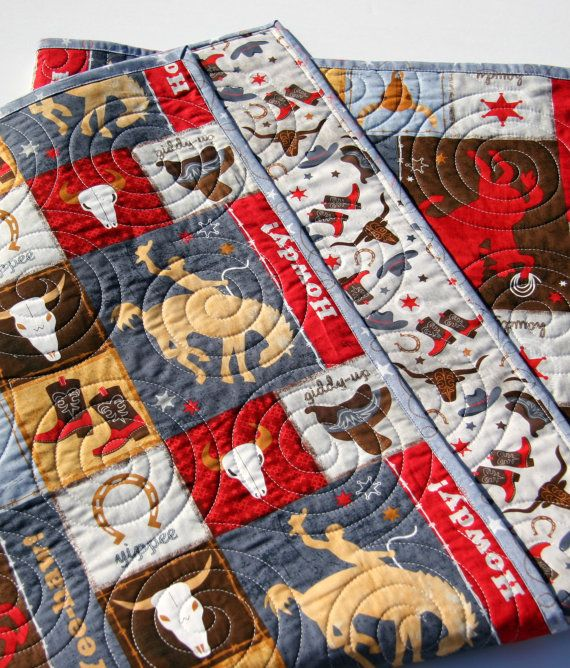 READY TO SHIP! This quilt was made with Learning the Ropes fabrics by Wilmington Fabrics. The colors red, blue, brown, yellow-gold, and gray. You can choose the size baby (39x47) or toddler (39x54). Your little cowboy or cowgirl will love all the western things going on in this quilt~!  QUILTERS: We have a QUILT KIT here available for purchase: https://www.etsy.com/listing/485100981/western-baby-quilt-kit-learning-the  A quilt is three layers stitched together, with t...
