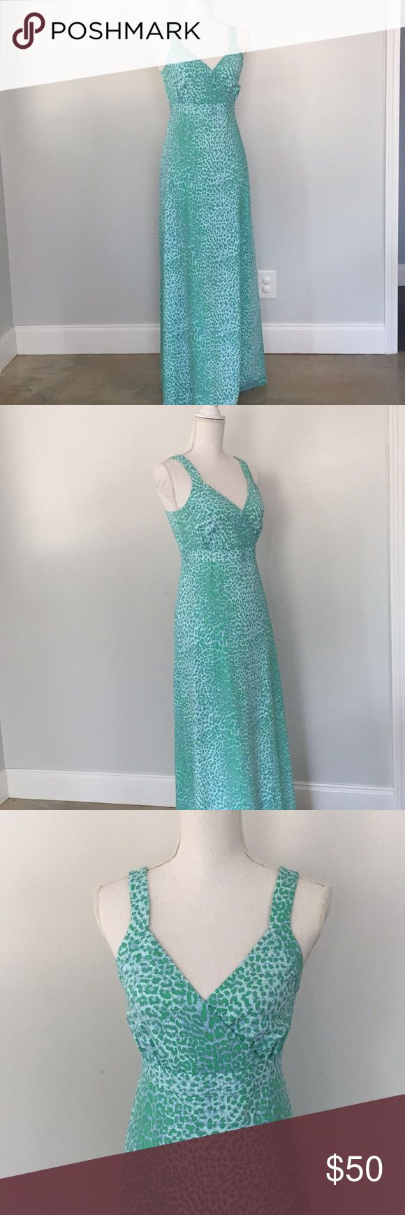 """J. McLaughlin Blue Green Animal Print Maxi Dress J. McLaughlin blue and green Animal Print maxi dress. Size small. In good used condition.   Unlined, Faux wrap, hidden center back zipper.   Measurements Length - 56"""" Chest - 15.5"""" Waist - 14""""  Feel free to ask any questions. No trades, offers welcome. J. McLaughlin Dresses Maxi"""