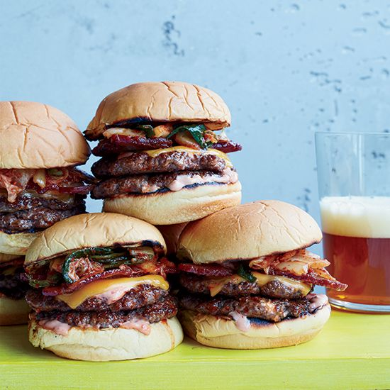 Bacon-and-Kimchi Burgers | Chef Wesley Genovart makes this over-the-top, Shake Shack–inspired burger with two thin stacked patties, thick-cut bacon, kimchi and a spicy homemade sauce.