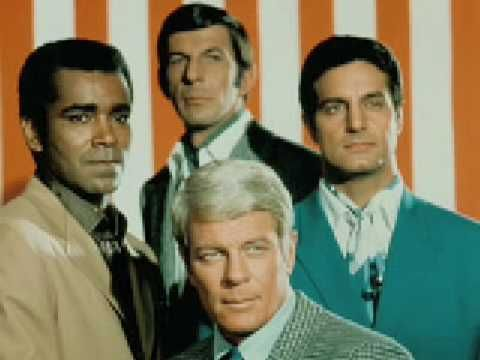 Mission Impossible CBS 09/66-03/73 The show chronicles the mission of the Impossible Missions Force. The show starred Peter Graves as Jim Phelps, Barbara Bain as Cinnamon Carter, Greg Morris as Barney Collier, Peter Lupus as Willy Armitage, and Martin Landau as Rollin Hand.  The show's famous scene is of the group getting a message on a recording that self-destructs.