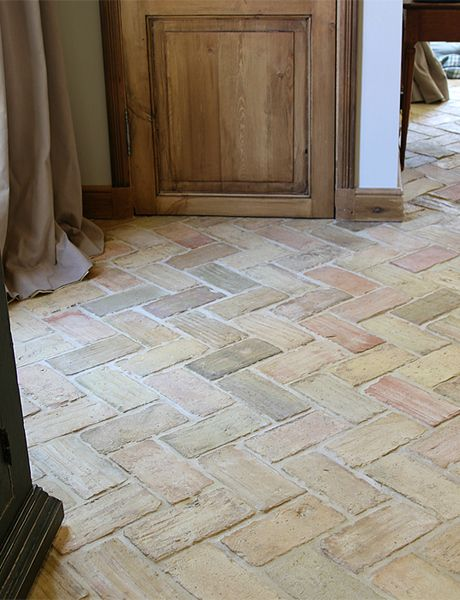Genuine antique terra cotta flooring tiles. No two floors are identical, the variation of hue, shape and color makes antique terra cotta a unique and impressive material. Lovingly salvaged. Exquisite Surfaces