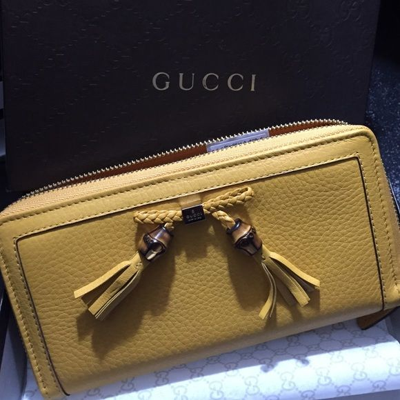 ❤️SaleGucci Wallettodays special only BNIB with tags, never used. Still has the brand new and leather'y smell when box opened. Very rich yellow and truly a fashionista statement Gucci Bags