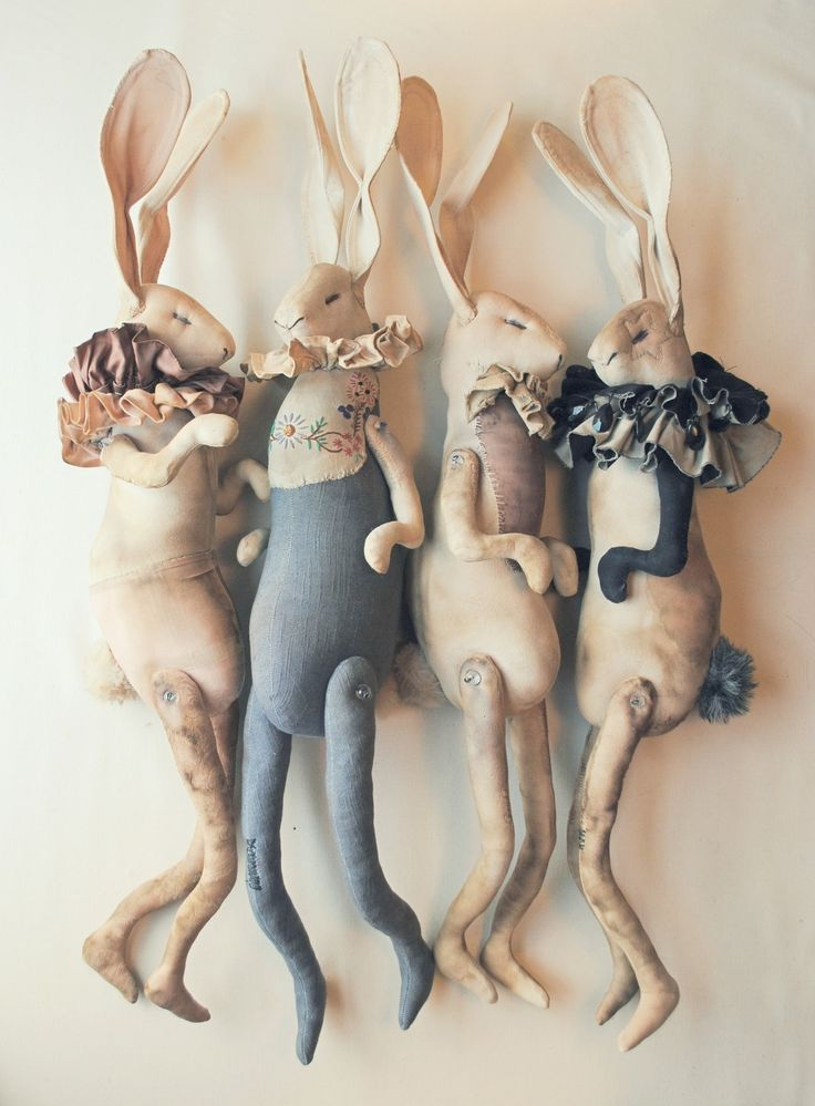 Mister Finch's work always has a hint of whimsy, paired with fantastic quality in the details.  Textile Hare Dolls By Mister Finch