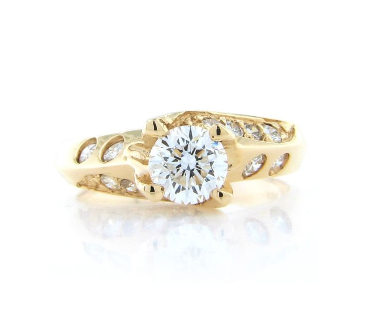 Yellow gold engagement rings are making a statement again.