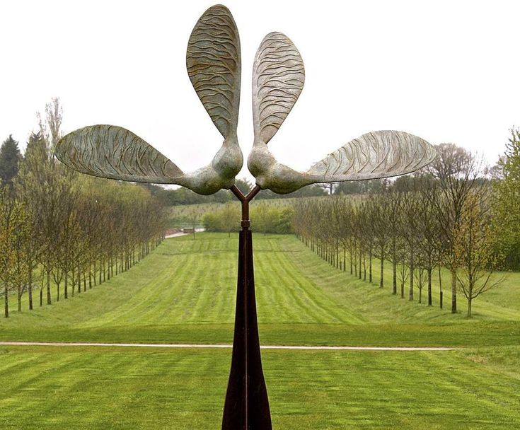 Kinetic Sycamore Seed sculpture in bronze and steel