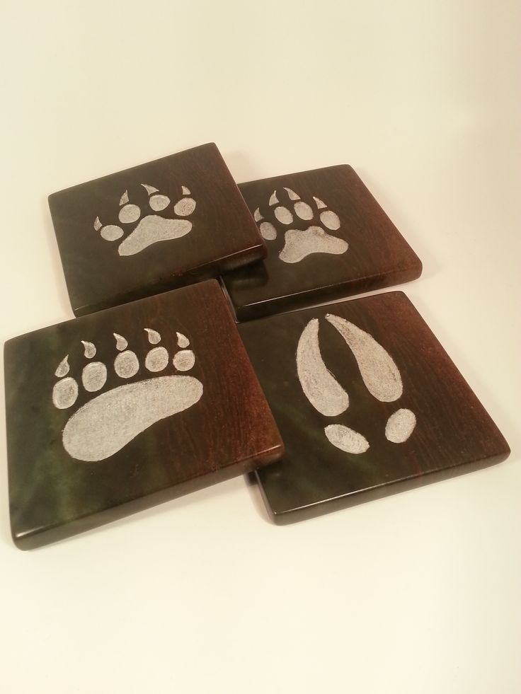 Hand carved stone coaster set for that unique and formal home decor setting.  Beautiful stone with hand carved animal tracks.  Can be ordered in any set variation.  www.artinstones.com