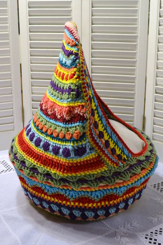 Crochet Cat Cave Pet Bed Upcycled Wicker Basket Mulitcolor Boho Handmade Littlestsister  A crocheted cat cave pet bed upcycling a wicker basket! I covered the basket outside with multi-colored acrylic yarn using a variety of stitches for a really unique look! The cushion in polyfil and heavy cotton fabric and is washable. I think it needs a blanket to make it extra special, but am leaving the color choice up to you.  Unique home for your artsy kitty!  The bed measures about 17 inches high…