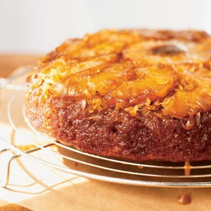 Pineapple-Coconut-Banana Upside-Down Cake - Upside-down cakes are classically made in a cast-iron skillet because it gives the cake a crisp edge, cooks it evenly, and keeps it moist. Instead of a pineapple-only cake, this version features coconut and banana and give the cake a more tropical flavor.