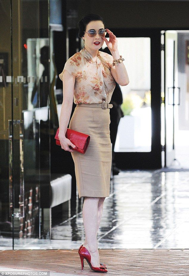 Retro and ravishing: Dita Von Teese looked feminine in her floral blouse and…